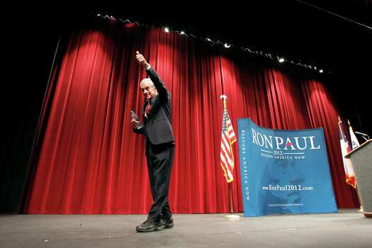 Ron Paul gives a thumbs up to his supporters while leaving the stage after holding a town hall meeting at Will Rogers Memorial Center in Fort Worth, Texas, on Wednesday, April 11, 2012. Photo: Lara Solt, Associated Press / The Dallas Morning News