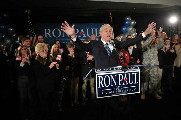 Ron Paul greets supporters at the Courtyard Des Moines Ankeny in Ankeny, Iowa after his third-place finish in the Iowa caucus on Jan. 3, 2012. Photo: Mark Kegans, Getty Images / 2012 Getty Images