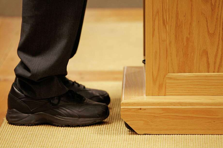 Ron Paul wears black leather Reebok shoes while holding a campaign town hall meeting with employees of Timberland LLC on Jan. 9, 2012 in Stratham, N.H. Photo: Chip Somodevilla, Getty Images / 2012 Getty Images
