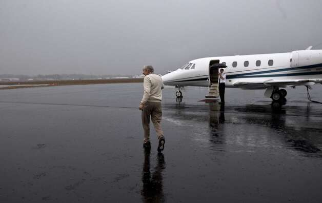 Ron Paul returns to his plane after a campaign stop at the Greenville/Spartanburg Whistle Stop at the Greenville Downtown Airport January 20, 2012 in Greenville, S.C. Photo: John W. Adkisson, Getty Images / 2012 Getty Images