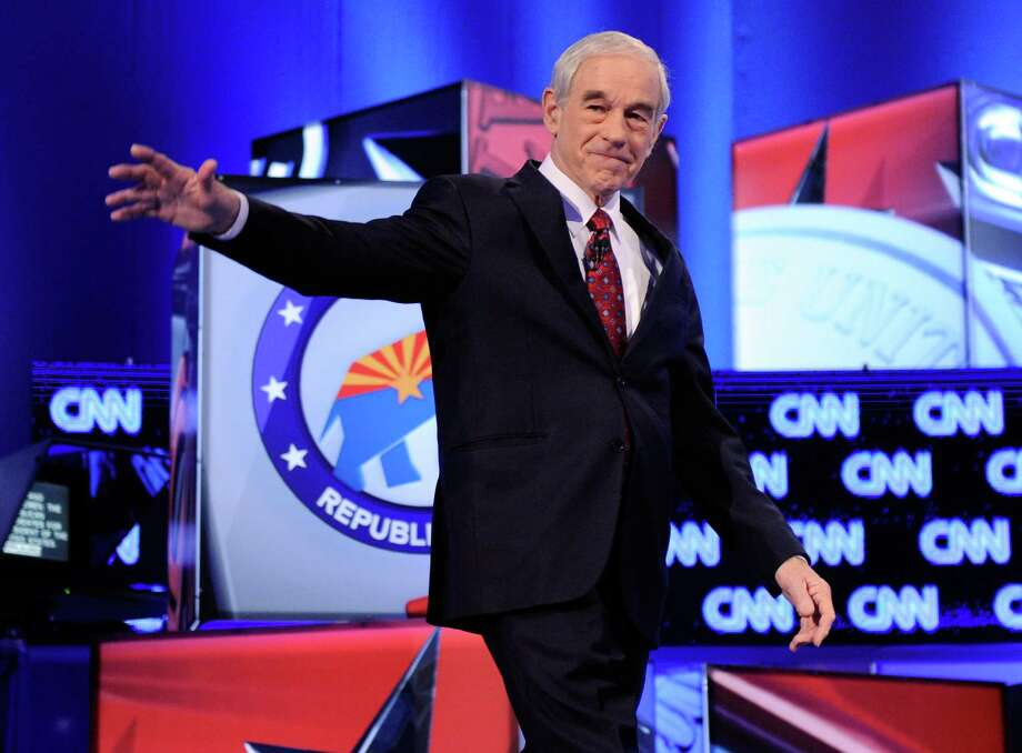Ron Paul waves as he is introduced at a debate sponsored by CNN and the Republican Party of Arizona at the Mesa Arts Center February 22, 2012 in Mesa, Arizona. Photo: Ethan Miller, Getty Images / 2012 Getty Images