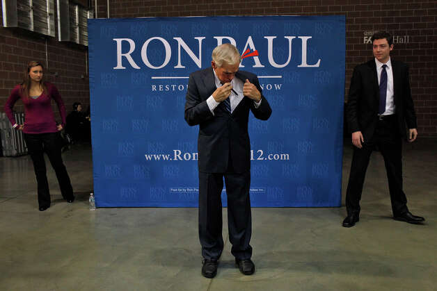 Ron Paul gets ready to pose for photos with supporters after speaking at his Salute to Veterans rally at the Iowa State Fairgrounds in Des Moines, IA on Wednesday, Dec. 28, 2011. Photo: LISA KRANTZ, SAN ANTONIO EXPRESS-NEWS / SAN ANTONIO EXPRESS-NEWS