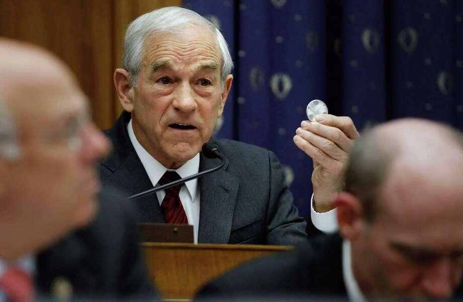 Ron Paul holds up a one-ounce silver coin while questioning Federal Reserve Bank Board Chairman Ben Bernanke during a full hearing of the House Financial Services Committee on Capitol Hill February 29, 2012 in Washington, DC. Photo: Chip Somodevilla, Getty Images / 2012 Getty Images