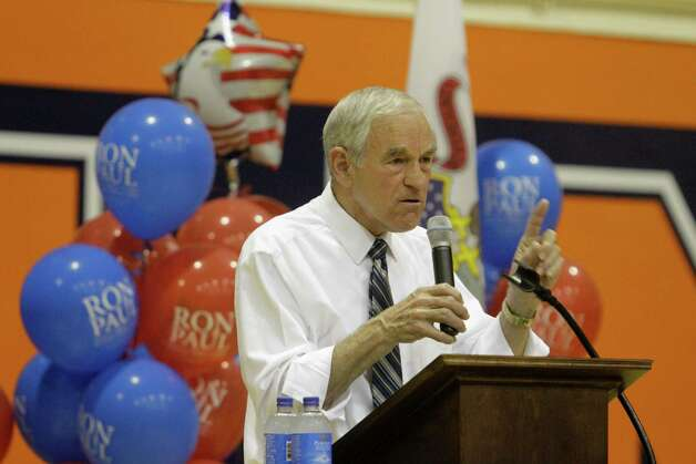 Ron Paul talks to supporters during a campaign rally Wednesday, March 14, 2012 in Champaign, Ill. Photo: Seth Perlman, Associated Press / AP