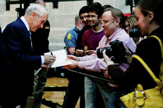 Ron Paul autographs a supporter's book during a town hall meeting at the University of Maryland on March 28, 2012 in College Park, Maryland. Photo: T.J. Kirkpatrick, Getty Images / 2012 Getty Images