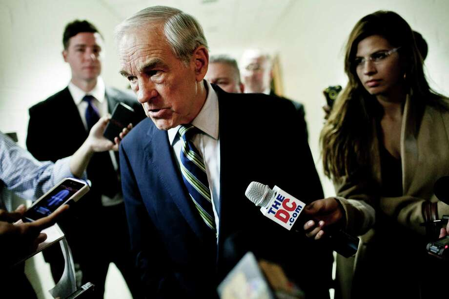 Ron Paul talks with the press after a town hall meeting at the University of Maryland on March 28, 2012 in College Park, Maryland. Photo: T.J. Kirkpatrick, Getty Images / 2012 Getty Images