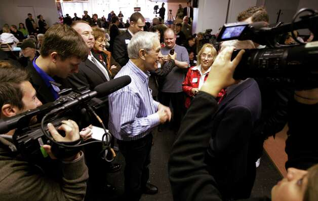Ron Paul talks to reporters as he attends a Washington state caucus meeting, Saturday, March, 3, 2012, in Puyallup, Wash. Photo: Ted S. Warren, Associated Press / AP