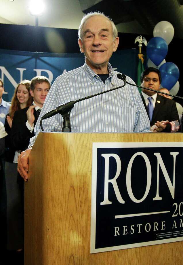 Republican presidential candidate Rep. Ron Paul, R-Texas, speaks Saturday, March 3, 2012, in Seattle. Paul was in Washington state for the Republican caucuses. (AP Photo/Ted S. Warren) Photo: Ted S. Warren, Associated Press / AP