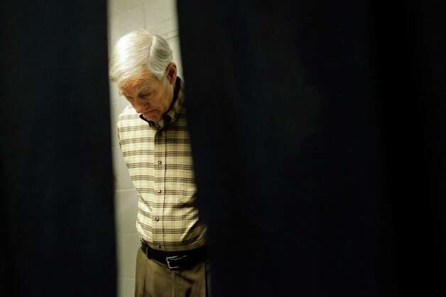 "FILE - Republican presidential candidate Rep. Ron Paul, R-Texas, waits backstage as he prepares to speak at CenturyLink Arena in this Feb. 18, 2012 file photo in Boise, Idaho.  This year, the state Republican Party opted for a ""Super Tuesday"" caucus, to lure GOP candidates to a state they've traditionally ignored during election years, despite its strong Republican roots. It's worked: Former Massachusetts Gov. Mitt Romney, Texas Congressman Ron Paul, ex-Pennsylvania Sen. Rick Santorum came in recent days, ahead of Tuesday's big event. (AP Photo/Marcio Jose Sanchez, File) Photo: Marcio Jose Sanchez, Associated Press / AP2012"