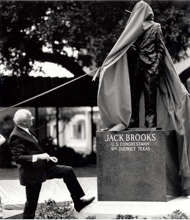 Jack Brooks watches as the curtain is removed from from his likeness at Lamar University in 1989. (Beaumont Enterprise)