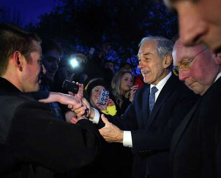 Ron Paul shakes hands at a campaign event at the University of Wisconsin campus in Madison, Wis., on Thursday, March 29, 2012. Photo: Craig Schreiner, Associated Press / Wisconsin State Journal