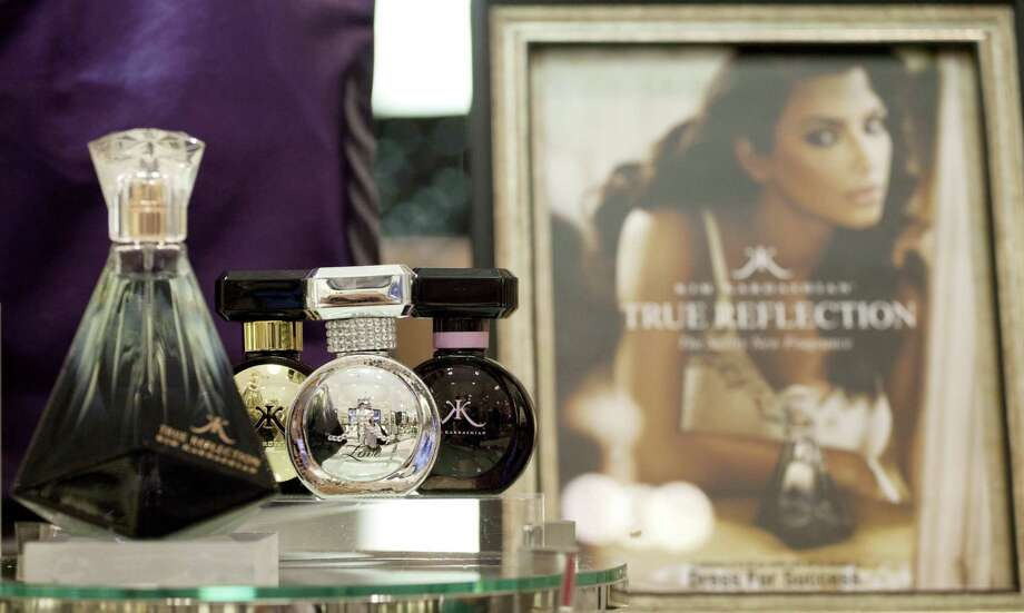 In this Aug. 23, 2012, photo, fragrances from the Kim Kardashian collection are displayed at a Lord & Taylor department store in New York.  Celebrities have long dabbled in design, but with the growth of TV shows and websites that follow everything celebrities say, wear and do, interest in their clothing lines has risen in recent years. North America revenue from celebrity clothing lines, excluding merchandise linked to athletes, rose 6 percent last year to an historic peak of $7.58 billion in 2011, according to the latest figures available by The Licensing Letter, an industry trade. That?s on top of a nearly 5 percent increase in 2010.  (AP Photo/Mark Lennihan) Photo: Mark Lennihan, STF / AP