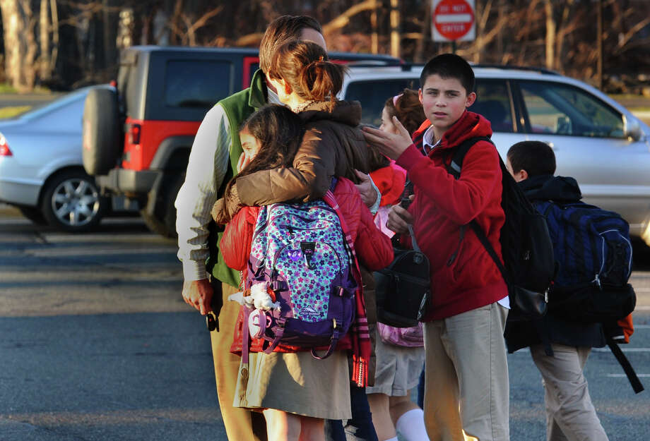 Parents and children leave St. Rose School after a lockdown following a shooting at nearby Sandy Hook Elementary School in Newtown, Conn., on Friday, Dec. 14, 2012. Photo: Christian Abraham / Connecticut Post