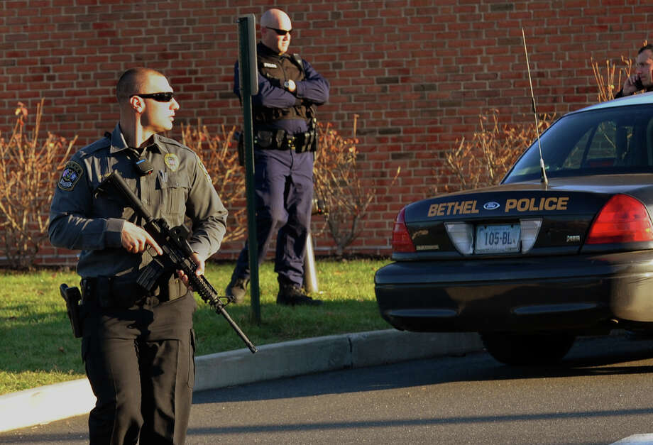 Police guard St. Rose School after a lockdown following the shootings at nearby Sandy Hook Elementary School in Newtown, Conn., on Friday, Dec. 14, 2012. Photo: Christian Abraham / Connecticut Post