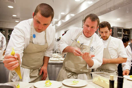 Chef Jason Franey (center) during a 2012 event at the Restaurant at Meadowood. Also pictured, Canlis executive sous chef Patrick Ayres and Meadowood sous chef Poncho Vasquez (Creel Films)