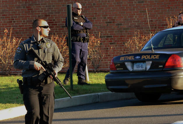 After a horrific shooting at Sandy Hook Elementary School nearby, police on the scene at St. Rose School after a lockdown at the school in Newtown, Conn. on Friday December 14, 2012. Photo: Christian Abraham / Connecticut Post