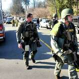 State Police respond after shootings at the Sandy Hook Elementary School Friday, Dec. 14, 2012.