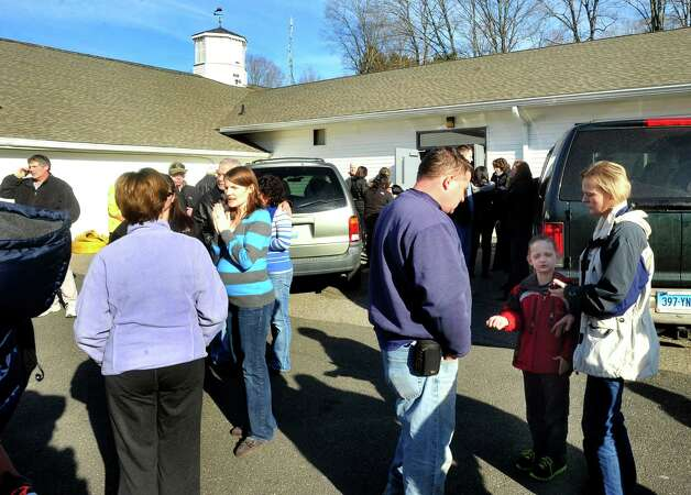 Parents of Sandy Hook Elementary School students look for their children at the Sandy Hook Firehouse after shootings at the school Friday, Dec. 14, 2012. Photo: Michael Duffy / The News-Times