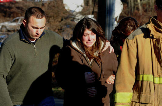 After a horrific shooting at Sandy Hook Elementary School nearby, a grief stricken couple leave the fire station on Riverside Drive in Newtown, Conn. on Friday December 14, 2012. Photo: Christian Abraham / Connecticut Post