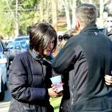 Parents of Sandy Hook Elementary School students share their grief outside the Sandy Hook Firehouse after shootings at the school Friday, Dec. 14, 2012.