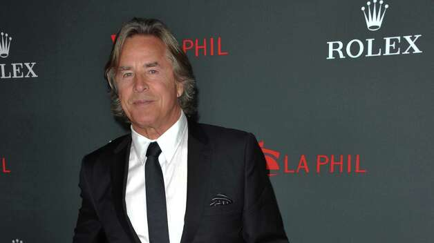 "FILE - In this Thurs., Sept. 27, 2012 file photo, Don Johnson arrives at the Los Angeles Philharmonic's 2012 Opening Night Gala, in Los Angeles. An appeals court on Monday Oct. 1, 2012 trimmed Johnson's $23.2 million verdict over ""Nash Bridges"" profits down to $15 million plus interest after determining that jurors mistakenly awarded Johnson interest in their original verdict. (Photo by Richard Shotwell/Invision/AP, File) Photo: Richard Shotwell / Invision"