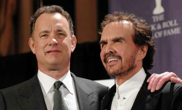 Actor Tom Hanks, left, and musician Dave Clark of the band the Dave Clark Five, pose backstage at the Rock and Roll Hall of Fame Induction Ceremony, Monday, March 10, 2008, in New York.  (AP Photo/Evan Agostini) Photo: Evan Agostini / AGOEV