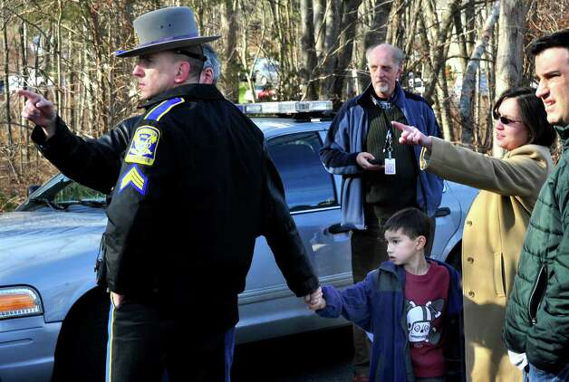 Parents of Sandy Hook Elementary School students talk to police following shootings at the school on Friday, Dec. 14, 2012. Photo: Michael Duffy / The News-Times