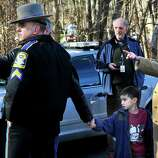 Parents of Sandy Hook Elementary School students talk to police after shootings at the school Friday, Dec. 14, 2012.