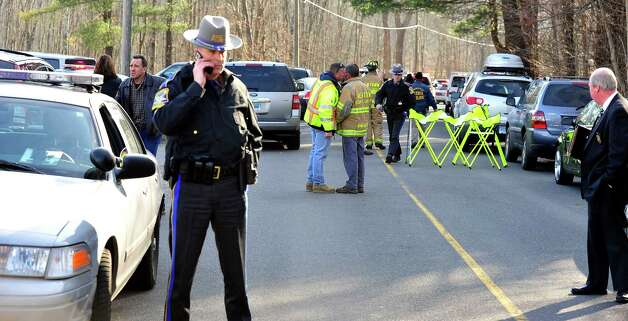 This is the scene at the road leading to Sandy Hook Elementary School after shootings at the school Friday, Dec. 14, 2012. Photo: Michael Duffy / The News-Times