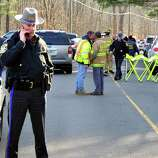 This is the scene at the road leading to Sandy Hook Elementary School after shootings at the school Friday, Dec. 14, 2012.