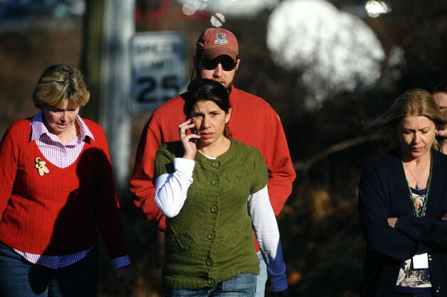 After a horrific shooting at Sandy Hook Elementary School nearby, families leave the Newtown Fire Station on Riverside Drive in Newtown, Conn. on Friday December 14, 2012. Photo: Christian Abraham / Connecticut Post