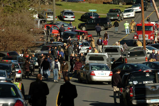 Dozens of police stage at the Sandy Hook Fire Department after a horrific shooting at Sandy Hook Elementary School nearby in Newtown, Conn. on Friday December 14, 2012. Photo: Christian Abraham / Connecticut Post