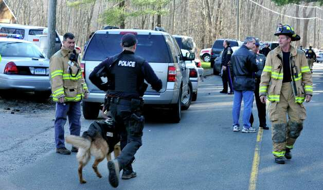 This is the scene at Dickenson Road leading to Sandy Hook Elementary School after shootings at the school Friday, Dec. 14, 2012. Photo: Michael Duffy / The News-Times