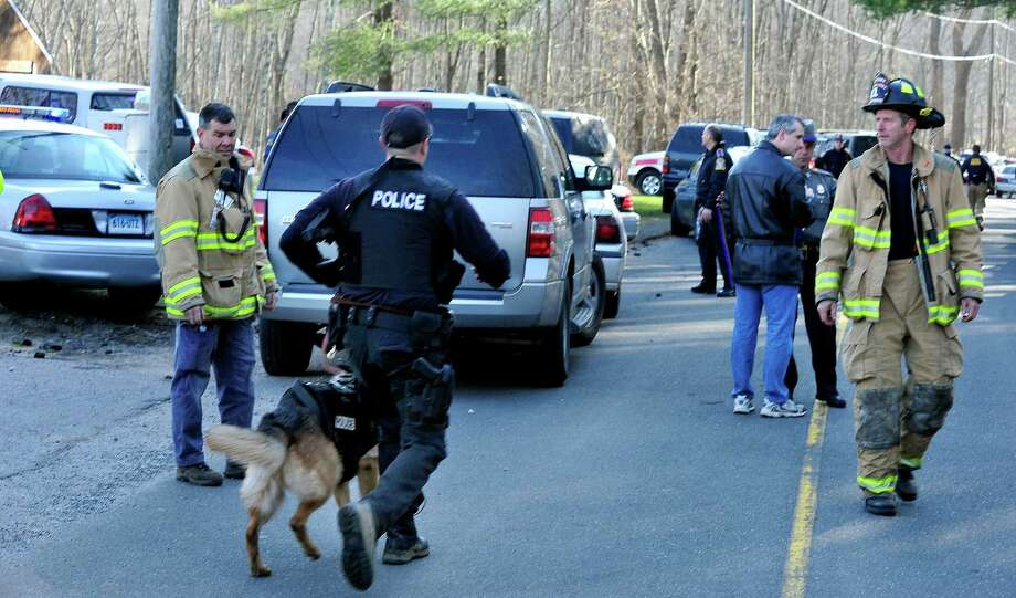 This was the scene at Dickenson Road leading to Sandy Hook Elementary School after shootings at the school Friday, Dec. 14, 2012. Photo: Michael Duffy / The News-Times