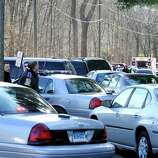 This is the scene at Dickenson Road leading to Sandy Hook Elementary School after shootings at the school Friday, Dec. 14, 2012.