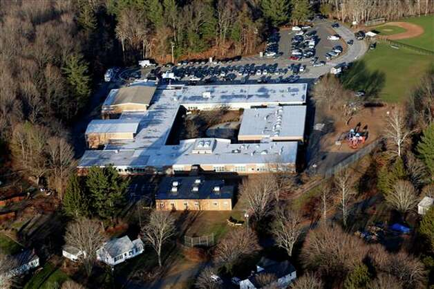 This aerial photo shows Sandy Hook Elementary School in Newtown, Conn., where authorities say a gunman opened fire inside the school in a shooting that left 27 people dead, including 20 young children, Friday, Dec. 14, 2012. (AP Photo/Julio Cortez) Photo: Julio Cortez, AP / AP
