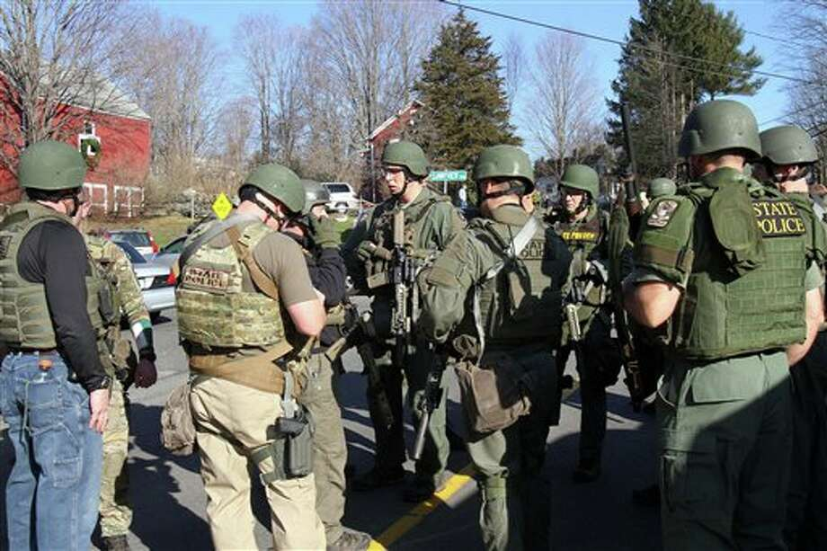 Heavily armed Connecticut State troopers are on scene at the Sandy Hook Elementary School following a shooting at the school, Friday, Dec. 14, 2012 in Newtown, Conn.  (AP Photo/The Journal News, Frank Becerra Jr.) MANDATORY CREDIT, NYC OUT, NO SALES, TV OUT, NEWSDAY OUT; MAGS OUT Photo: Frank Becerra Jr., AP / The Journal News