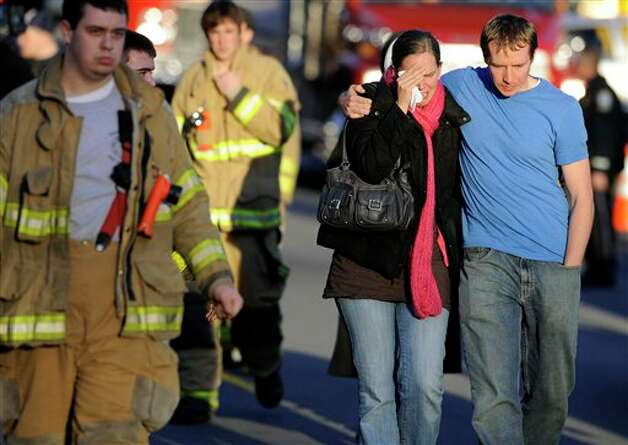Victims family leave a firehouse staging area following a shooting at the Sandy Hook Elementary School in Newtown, Conn., about 60 miles (96 kilometers) northeast of New York City, Friday, Dec. 14, 2012. An official with knowledge of Friday's shooting said 27 people were dead, including 18 children.  (AP Photo/Jessica Hill) Photo: Jessica Hill, ASSOCIATED PRESS / A2012