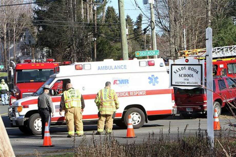 Ambulances leave the Sandy Hook Elementary School following a shooting at the school, Friday, Dec. 14, 2012 in Newtown, Conn. A man opened fire inside the Connecticut elementary school where his mother worked Friday, killing 26 people, including 18 children, and forcing students to cower in classrooms and then flee with the help of teachers and police. (AP Photo/The Journal News, Frank Becerra Jr.) MANDATORY CREDIT, NYC OUT, NO SALES, TV OUT, NEWSDAY OUT; MAGS OUT Photo: Frank Becerra Jr., ASSOCIATED PRESS / The Journal News2012
