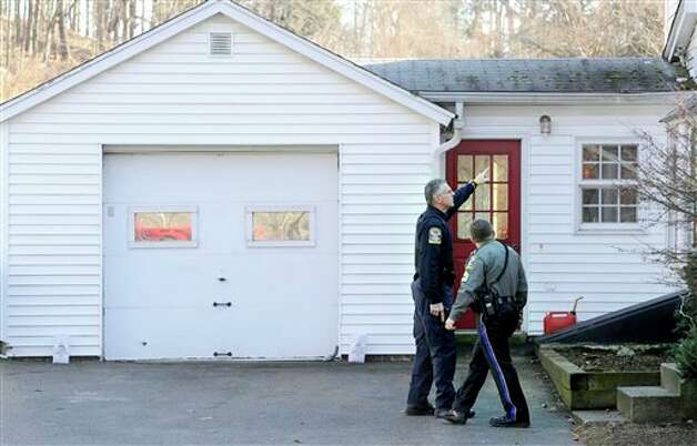 Law enforcement canvass an area nearby a school shooting at the Sandy Hook Elementary School in Newtown, Conn., about 60 miles (96 kilometers) northeast of New York City, Friday, Dec. 14, 2012. An official with knowledge of Friday's shooting said 27 people were dead, including 18 children. (AP Photo/Jessica Hill) Photo: Jessica Hill, ASSOCIATED PRESS / A2012