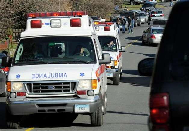 Ambulances leave an area near the scene of a shooting at the Sandy Hook Elementary School in Newtown, Conn., about 60 miles (96 kilometers) northeast of New York City, Friday, Dec. 14, 2012. An official with knowledge of Friday's shooting said 27 people were dead, including 18 children.  (AP Photo/Jessica Hill) Photo: Jessica Hill, ASSOCIATED PRESS / A2012