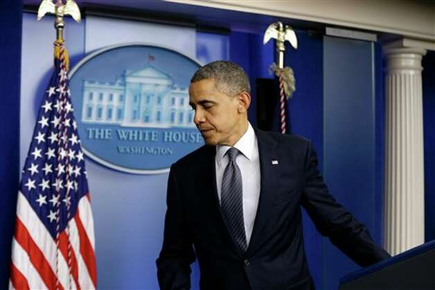 President Barack Obama leaves the podium after speaking about the school shooting in Newtown, Conn., Friday, Dec. 14, 2012, in the briefing room of the White House in Washington. (AP Photo/Charles Dharapak) Photo: Charles Dharapak, AP / AP