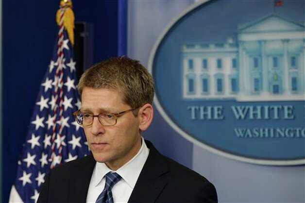 Press Secretary Jay Carney listens to a follow up question regarding the school shooting in Newtown, Conn., after he told reporters that President Barack Obama is receiving updates on the situation during the daily press briefing at the White House in Washington, Friday, Dec. 14, 2012. (AP Photo/Charles Dharapak) Photo: Charles Dharapak, ASSOCIATED PRESS / AP2012