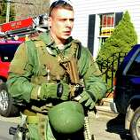 Armed State Police respond after shootings at the Sandy Hook Elementary School Friday, Dec. 14, 2012.