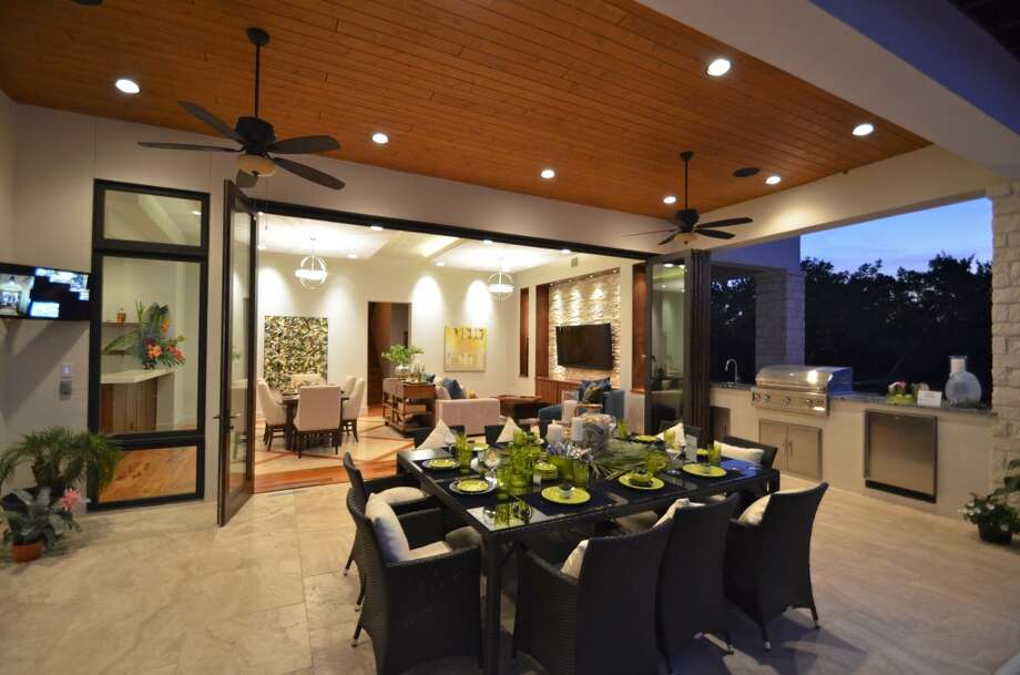 This home in The Dominion by Kyle Lindsey Custom Homes has an outdoor dining area and kitchen that can open up to the living area, creating one large space for entertaining. (Courtesy photo)