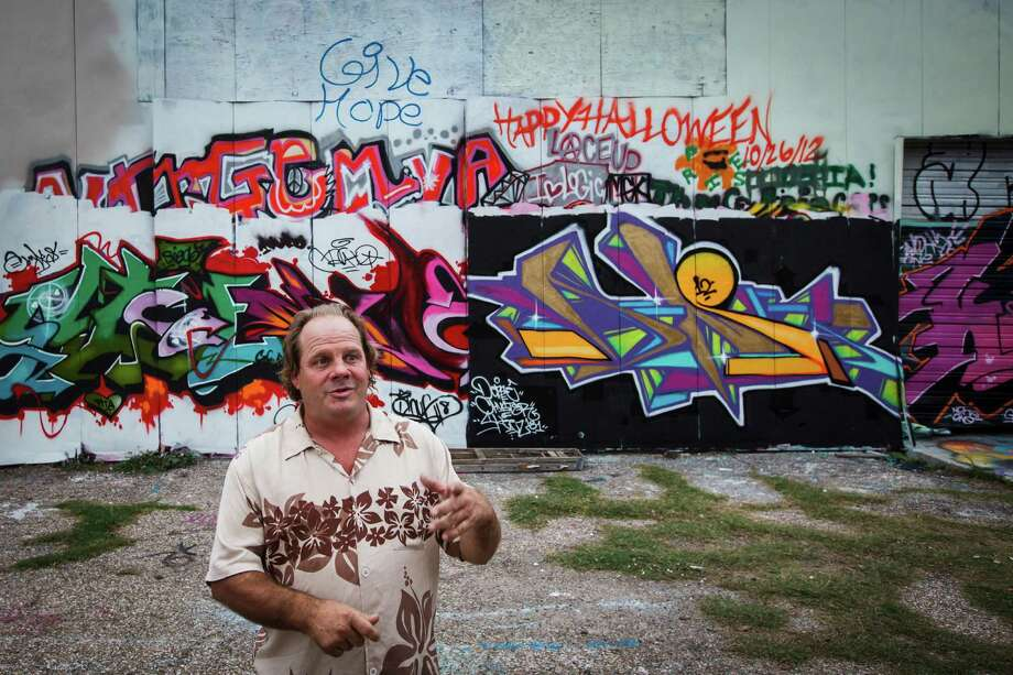 Johnathan Estes stands outside Kingspoint Mullet which is Houston's largest graffiti mecca and art space and is run by Southern Artists Foundation, a nonprofit organization that works to help autistic children, Tuesday, Dec. 4, 2012, in Houston.  ( Michael Paulsen / Houston Chronicle ) Photo: Michael Paulsen, Staff / © 2012 Houston Chronicle