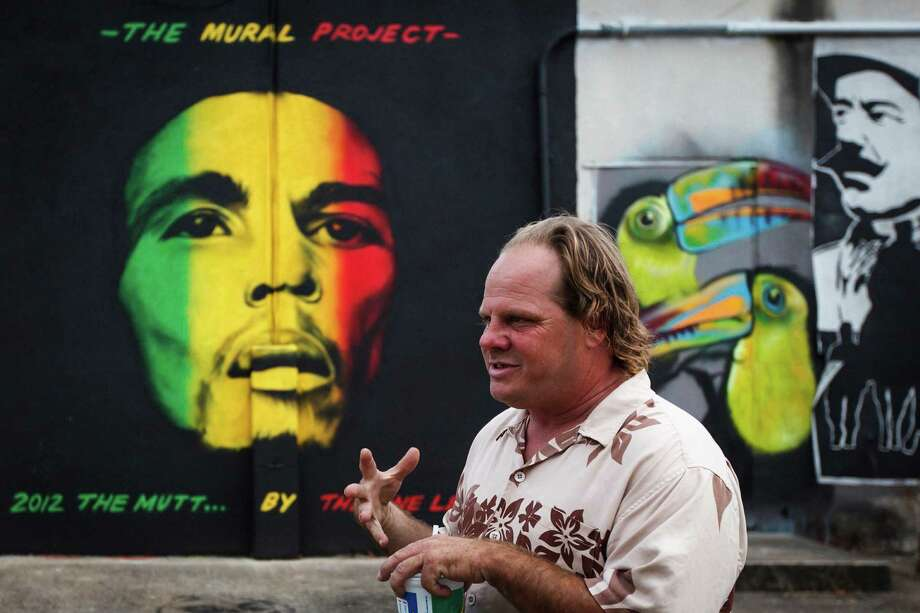 Johnathan Estes at the Mullet in 2012, with a painting by The One Lee. Photo: Michael Paulsen, Staff / © 2012 Houston Chronicle