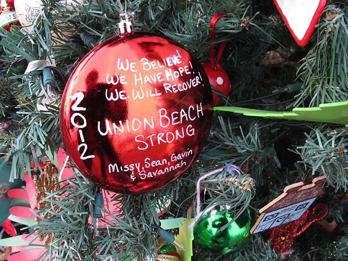 Hand-made ornaments adorn the tree, which was found in rubble.