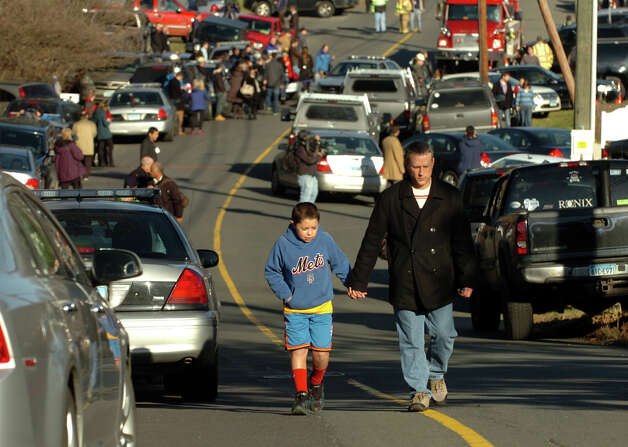 After a horrific shooting at Sandy Hook Elementary School nearby, families leave the Sandy Hook Fire Department where they gathered in Newtown, Conn. on Friday December 14, 2012. Photo: Christian Abraham / Connecticut Post