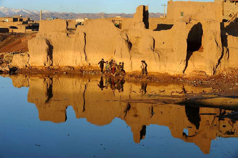 Afghan children playnear a lake on the outskirts of Herat. Photo: Aref Karimi, AFP/Getty Images